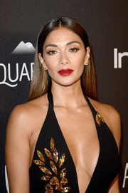 Nicole Scherzinger wore her hair sleek straight with a center part at the InStyle and Warner Bros. Golden Globes post-party.
