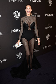 Whitney Port flashed plenty of skin at the InStyle and Warner Bros. Golden Globes post-party in a black Michael Costello mesh dress that put a super-sexy spin on the classic mermaid silhouette.