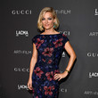 Lucy Walker in a floral column dress
