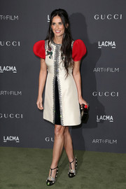 Demi Moore looked princess-y in a Gucci cocktail dress with puffed sleeves and beaded trim at the 2016 LACMA Art + Film Gala.
