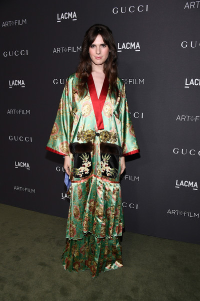Hari Nef in a satin robe-inspired look