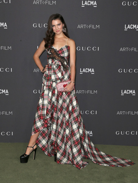 Maya Henry in a strapless plaid gown