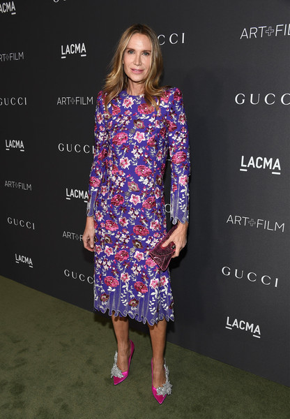 Kelly Lynch in a floral printed dress
