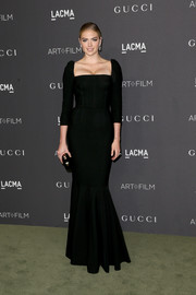 Kate Upton looked downright elegant in a black square-neck mermaid gown by Dolce & Gabbana at the 2016 LACMA Art + Film Gala.