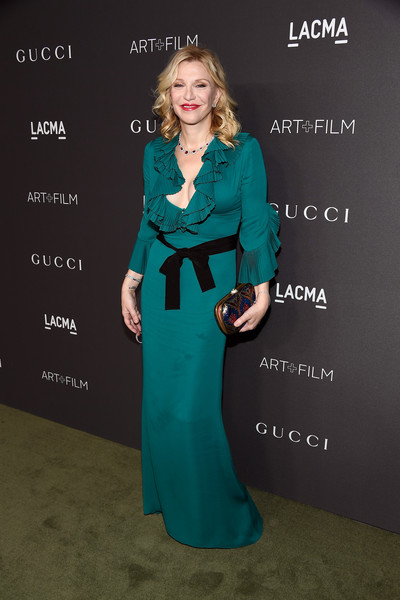 Courtney Love in a ruffled teal dress
