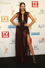 Ksenija Lukich teamed her alluring dress with black cage boots, also by Burberry.