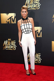 Carrie Keagan showed off her unique style in a white side-striped jumpsuit with a grid bodice at the MTV Movie Awards.