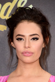 Chloe Bridges hit the MTV Movie Awards red carpet sporting a messy ponytail.