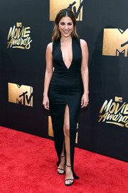 Liz Hernandez stole the spotlight in a form-fitting Lexi gown with a plunging neckline and a thigh-high slit during the MTV Movie Awards.
