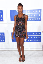 Jasmine Tookes looked beach-ready in a sequined cutout dress layered over a black two-piece while attending the 2016 MTV VMAs.