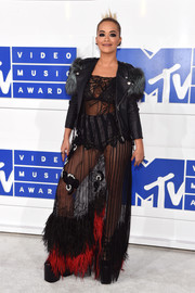 Rita Ora topped off her revealing dress with a fur-embellished leather jacket, also by Marc Jacobs.