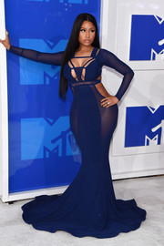 Nicki Minaj got majorly flirty in a sheer blue cutout mermaid gown by Bao Tranchi for the 2016 MTV VMAs.