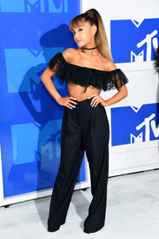 Ariana Grande contrasted her flirty top with baggy black pants, also by Alexander Wang.