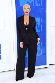 Amber Rose went androgy-sexy in a black pantsuit teamed with a lacy bra for her 2016 MTV VMA look.