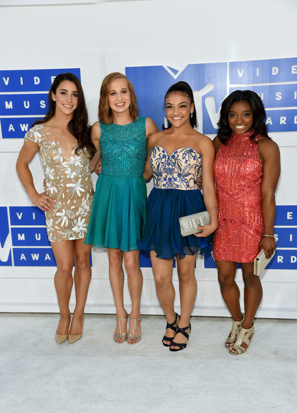 Simone Biles chose a beaded coral cocktail dress by Sherri Hill for the 2016 MTV VMAs.