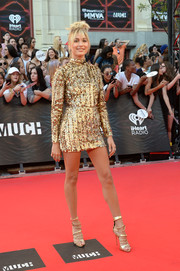 Hailey Baldwin's strappy gold Giuseppe Zanotti heels were the perfect finishing touch to her fabulous dress!