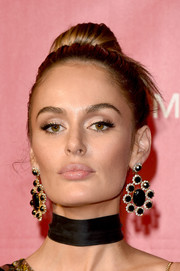 Nicole Trunfio swept her hair up into a classic bun for the MusiCares Person of the Year event.