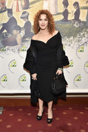 Bernadette Peters completed her all-black look with a vintage-chic embroidered tote.