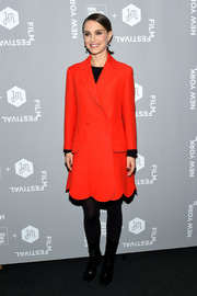 Natalie Portman was sweet and elegant in a red scallop-hem coat by Christian Dior at the New York Jewish Film Fest screening of 'A Tale of Love and Darkness.'