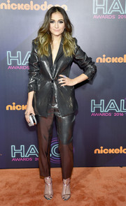 Daya went all out with the shine, pairing her suit with gold T-strap sandals.