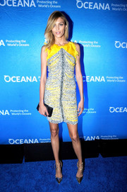 Anja Rubik finished off her outfit with strappy gold pumps.