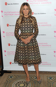 Sarah Jessica Parker completed her look with bedazzled T-strap pumps from her own line.