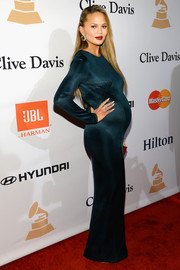 Chrissy Teigen attended the Pre-Grammy Gala wearing a teal Galvan maternity dress that fit her like a second skin.