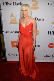Natasha Bedingfield made a red-hot appearance at the Pre-Grammy Gala in a draped red cutout gown.