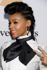 Janelle Monae sported her signature pompadour braid at the Pre-Grammy Gala.