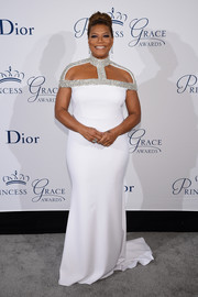Queen Latifah commanded attention in a white Christian Siriano gown with a bedazzled cutout neckline at the Princess Grace Awards Gala.