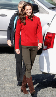 Kate Middleton kept cozy with a red cable-knit mock turtleneck from Really Wild while out on a fishing trip in Canada.