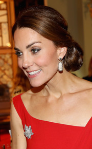 Kate Middleton styled her hair into a very ladylike side chignon for a reception during her tour of Canada.