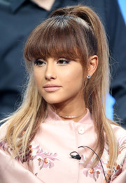 Ariana Grande swiped on some pale pink lipstick to match her jacket.