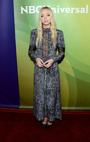 Portia Doubleday attended the NBCUniversal Summer TCA Tour wearing a black-and-white sheer-panel print dress.