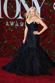 Megan Hilty got majorly frilled up in a  Matthew Christopher strapless navy  mermaid gown for the 2016 Tony Awards.