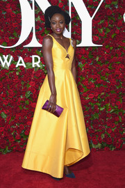 Danai Gurira pulled her colorful look together with a purple satin clutch by Roger Vivier.