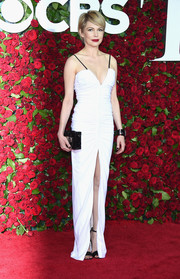 Michelle Williams flaunted her super-slim figure at the 2016 Tony Awards in a ruched white Louis Vuitton gown with black spaghetti straps, a deep-V neckline, and a high front slit.