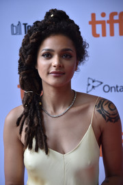 Sasha Lane looked oh-so-cool with her side-swept dreadlocks at the TIFF premiere of 'American Honey.'