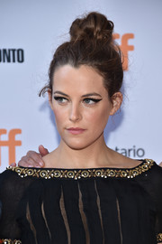 Riley Keough swept her hair up into a messy knot for the TIFF premiere of 'American Honey.'