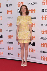 Emma Stone was a glamorous drop of sunshine in this beaded yellow mini dress by Chanel at the TIFF premiere of 'La La Land.'