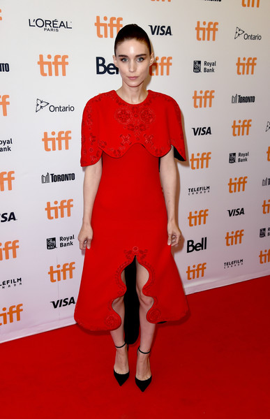 Rooney Mara, who always favors black or white, was a vision in red at the TIFF premiere of 'Lion.' Her capelet-accented dress was by Aouadi Couture.