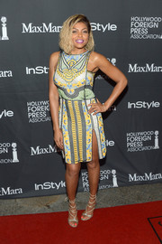 Taraji P. Henson attended the TIFF/InStyle/HFPA party wearing a colorful beaded dress by Naeem Khan.