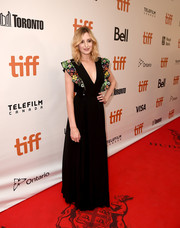 Laura Carmichael exuded girly appeal in a black Fendi gown with floral-embroidered butterfly sleeves during the TIFF premiere of 'A United Kingdom.'