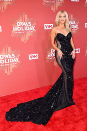 Bebe Rexha got majorly glammed up in a strapless, embellished fishtail gown by Galia Lahav Haute Couture for VH1's Divas Holiday: Unsilent Night.