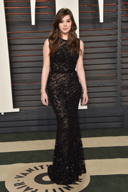 Hailee Steinfeld exuded classic glamour in a beaded black Elie Saab gown while attending the Vanity Fair Oscar party.