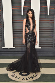 Chanel Iman made sure all eyes were on her when she wore this mega-vampy black cutout mermaid gown by Death by Dolls to the Vanity Fair Oscar party!
