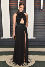Paula Patton flashed some cleavage and abs in a black cutout gown by Tadashi Shoji during the Vanity Fair Oscar party.