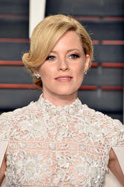 Elizabeth Banks went for old-school elegance with this rolled chignon at the Vanity Fair Oscar party.