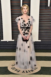 Emma Roberts looked enchanting at the Vanity Fair Oscar party in an appliqued tulle gown by Yanina Couture.