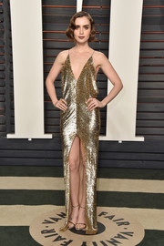 Lily Collins channeled her inner flapper girl in this gold sequin dress by Saint Laurent for the Vanity Fair Oscar party.